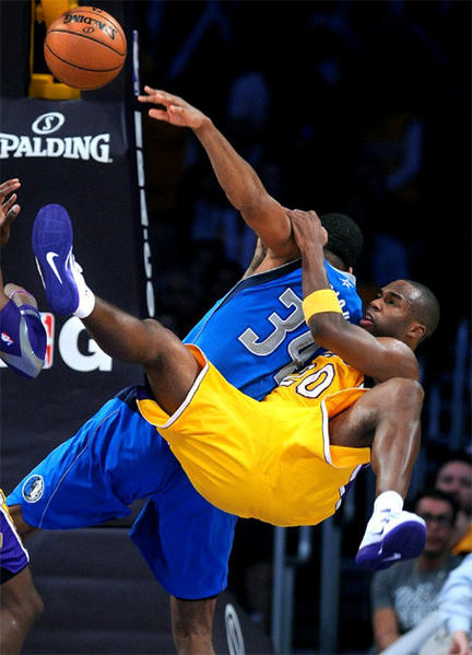 Jodie Meeks fouls Brandan Wright in Tuesday night's season opener at Staples Center.