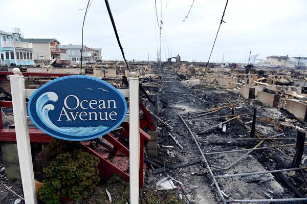 Photos: Hurricane Sandy: Homes on Ocean Avenue in the Breezy Point area of Queens in New York smolder the day after a fire destroyed about 80 homes as a result of Hurricane Sandy.