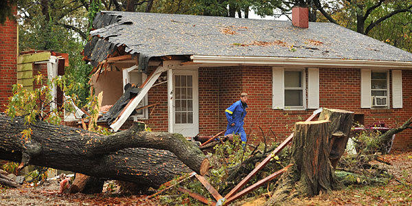 An Anne Arundel fire department official exits the Pasadena home where Donald C. Cannata, Sr., 74, was killed when an 80 ft. oak tree fell on the house. (Amy Davis, Baltimore Sun Photo)