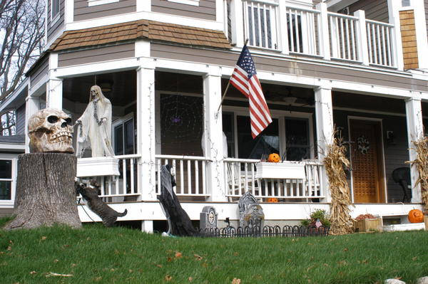 Ghosts, skulls and gravestones are common additions to flower boxes, flags and cats this time of year as homeowners decorate in anticipation of Halloween.