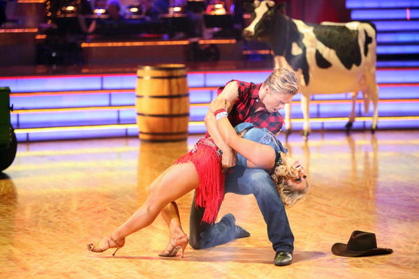 Each couple (pictured above: Derek Hough and Shawn Johnson) performed to a Country hit song where the celebrity was required to perform a solo during his or her routine.