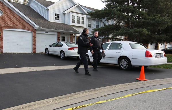 Police investigate the deaths of two children in the 800 block of Quin Court in Naperville, Ill.