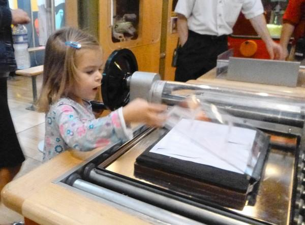 "Avery Oppermann, 3, explores the new ""How People Make Things"" exhibit at the DuPage Children's Museum in Naperville."