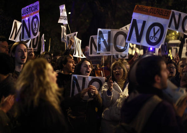 Protesters shout slogans against austerity measures announced by the Spanish government on Oct. 27. One Spaniard in four is now unemployed.