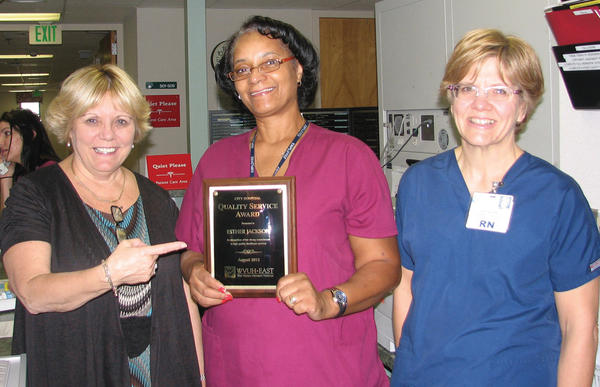 City Hospital's August Quality Service Award winner, Esther Jackson, center, is pictured receiving her award from Donna Clews, left, vice president of patient-care services, and Kathleen Kerstetter, medical/surgical nursing director.