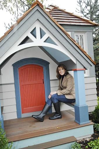 Sandy Arkell of Hinsdale won this playhouse during a Jr. Women's Club charity auction to benefit the Ronald McDonald House. She bid $14,000 on the house, donated by Chris Donatelli Builders, Inc., for her five-year-old son Johnathan. (Yes, that's Johnathan, with an 'h')