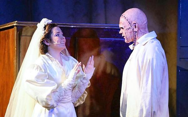 "Notre Dame Preparatory School's Nancy Padden, left, 17, and Loyola Blakefield's Nigel Goldsborough, 15, perform in ""Frankenstein"" at Loyola Blakefield in Towson. The two were part of a preview performance on Oct. 25. The show officially opened Oct. 26."
