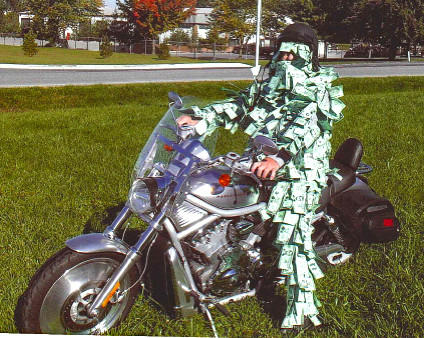 Deryle Bingaman, of Hagerstown, is shown wearing a costume of dollar bills he fashioned for Halloween, which he said he had hoped to wear in the Alsatia Mummers Parade in Hagerstown.