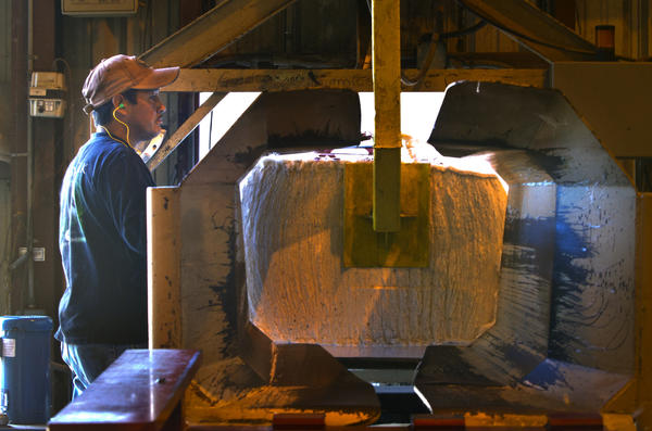 Abeldela Garza, packages a bale of cotton out of the bale press after processing at Commonwealth Gin in Windsor. The cotton has been cleaned and the seed removed during the ginning process. Each bale can weight as much as 460-520 lbs. 480 lbs. is the avg.