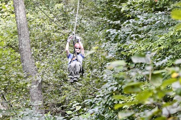 The writer, Matthew Sturdevant, on a zipline at the Navitat Zip Line Canopy tours near Asheville, N.C. Navitat canopy adventures is a thrilling zip-line tour for $89 per adult.