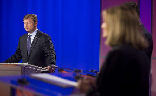 Sen. Dean Heller, (R-Nev.), waits for the start of a debate against Rep. Shelley Berkley, (D-Nev.) in Las Vegas.