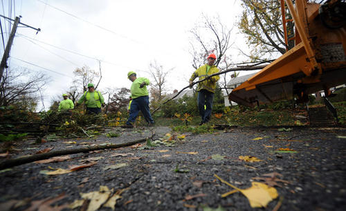 Workers from the Highway Department for the City of Easton clean-up debris from Hurricane Sandy along West Wayne Ave. in Easton Wednesday morning.