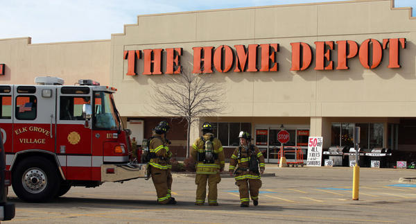 Elk Grove Village police and fire department personnel respond to a possible bomb threat at the Home Depot store at Biesterfield and Meacham roads on Wednesday morning. The store was evacuated and searched by investigators as well as bomb sniffing dogs.