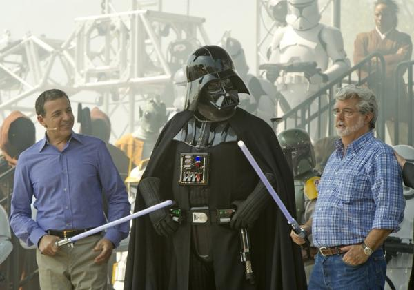 George Lucas, right, has agreed to sell LucasFilm, along with Darth Vader and the 'Star Wars' franchise, to Disney.