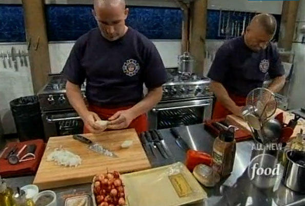 "Firefighters work in the ""Chopped"" kitchen."