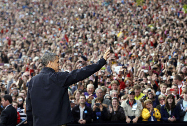 President Obama waves to supporters as he takes the stage during a campaign event at the University of Wisconsin-Madison.