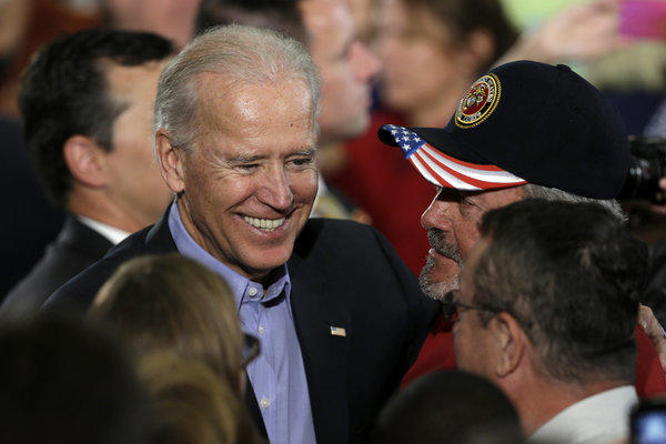 Vice President Joe Biden greets supporters after speaking at a campaign rally at the Municipal Auditorium in Sarasota, Fla.