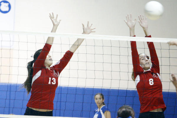 Burroughs' Caitlin Cottrell, left, and Danielle Ryan block a spike during a game against Burbank at Burbank High School on Wednesday, October 30, 2012.