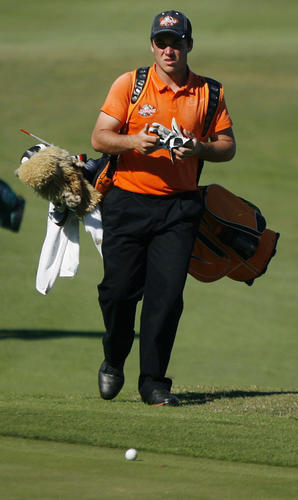 Ethan Wagner, Spruce Creek High, walks toward his ball on the fringe of the 18th green during the FHSAA Boys State Class 2A Golf Finals at Deer Island Country Club in Tavares, Fla.