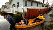 Sandy's grim death toll mounted Thursday as survivors struggled to regain a semblance of the normalcy that the storm swept away this week when it struck the Northeast.