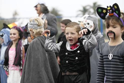 Tyler Hoffmann, 6, does his best vampire impression during a costume parade at Woodland Elementary School in Costa Mesa on Wednesday.