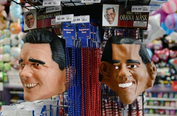 Mitt Romney and President Obama masks for sale at an Arlington, Va., party store.