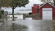"Hurricane Sandy's howling winds and torrential rains walloped Maryland late Monday and early Tuesday, cutting electricity to more than 300,000 utility customers and disrupting life for millions from <a href=""http://www.baltimoresun.com/travel/beaches/"">Ocean City</a> to the suddenly snowy mountains of Garrett County."