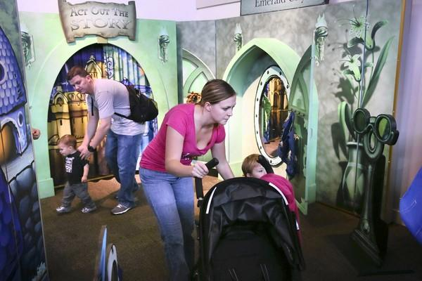 "Magdelena Kubik, right, and her son Dominik Kubik, 2, navigate the ""Wonderful World of Oz"" exhibit at the Kohl Children's Museum in Glenview."