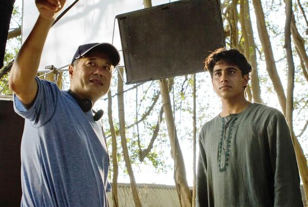 "Ang Lee, shown with ""Life of Pi"" titular star Suraj Sharma, chose to shoot the $120-million film in 3-D despite his lack of familiarity with the technique."