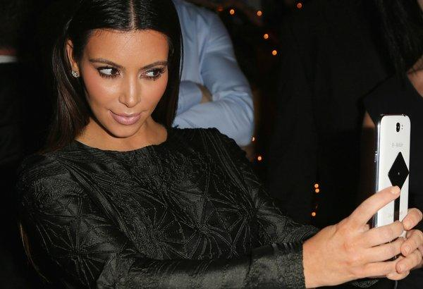 Kim Kardashian snaps herself at Samsung's official after-party celebrating LeBron James' championship ring presentation in Miami.