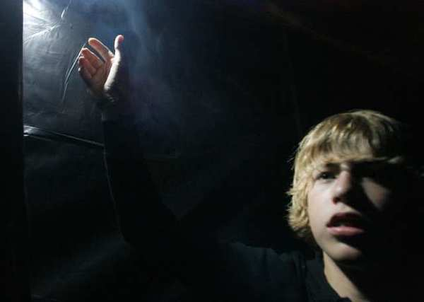 12-year-old Jeremy Herron gives a tour of a haunted maze he created in front of his La Canada home.
