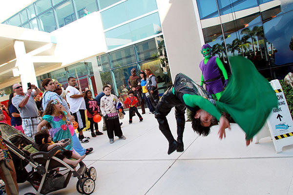 A man dressed as the Green Goblin does a back flip for the crowd at the Joe DiMaggio Children's Hospital's Happy Halloween Community Open House on Wednesday, October 31, 2012.