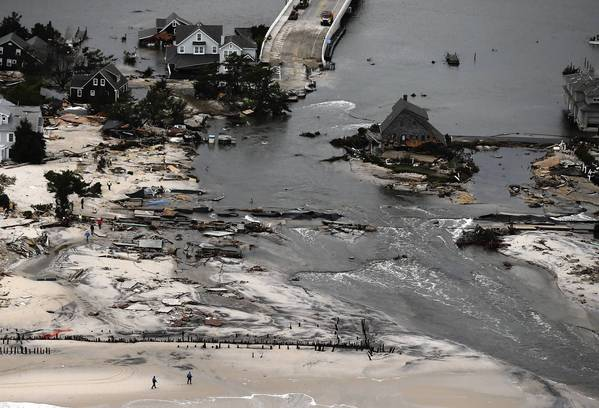 Photos: Hurricane Sandy: Homes sit in ruin at the end of a bridge wrecked by flooding from Hurricane Sandy in Mantoloking, New Jersey.