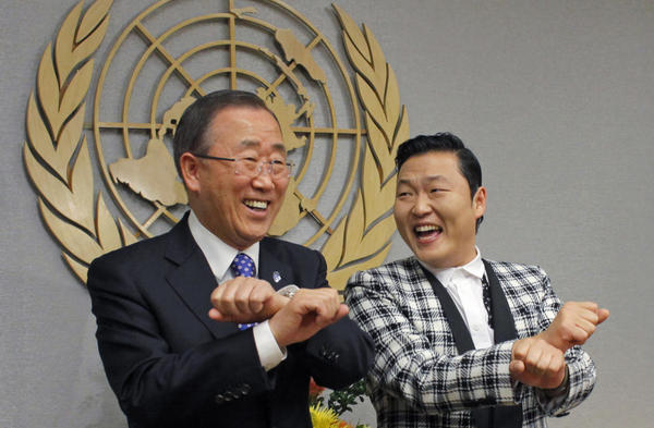 "South Korean singer Psy (R) practices some ""Gangnam Style"" dance steps with U.N. Secretary-General Ban Ki-moon during a photo opportunity at the U.N. headquarters in New York."