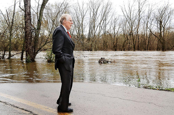 U.S. Rep Roscoe Bartlett, R-Md., inspects the swollen Conococheague Creek at Wishard Road Wednesday during a tour of storm damage in Washington County.