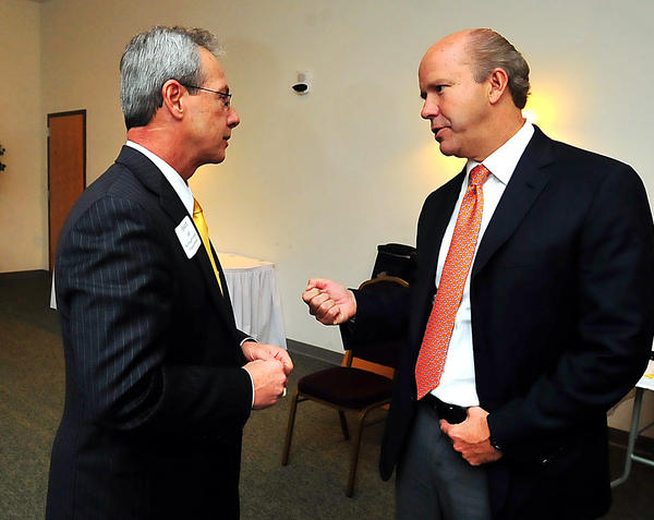 6th District congressional hopeful John Delaney, right, chats with Ed Lough Wednesday at a Hagerstown-Washington County Chamber of Commerce candidates forum.