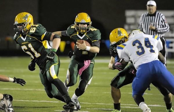 Stevenson quarterback William Bourbon follows his blockers through a hole up the middle. Stevenson defeated Warren 26-13 in the first round of the Class 8A playoffs on Fri., Oct. 25, 2012, at Stevenson High School in Lincolnshire, Ill.