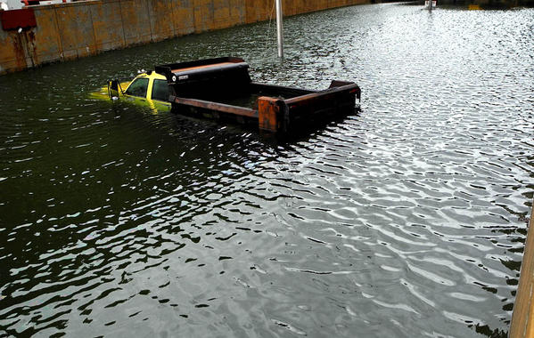 An abandoned truck is almost entirely submerged by flood waters in the Battery Park Underpass in Lower Manhattan.