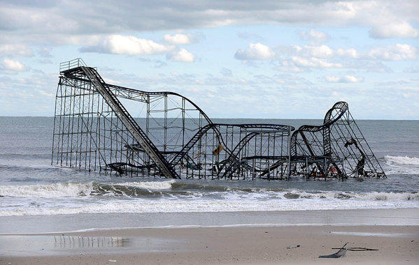 The Casino Pier roller coaster in Seaside Heights, N.J. lies crumpled in the ocean after the pier was destroyed by Hurricane Sandy.