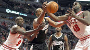 Bulls open with 93-87 victory over Kings