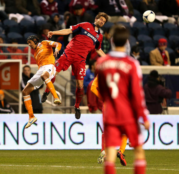 Arne Friedrich attempts a header against the Dynamo in the first half.