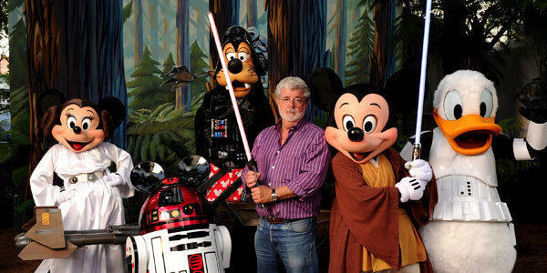 """Star Wars"" creator and filmmaker George Lucas poses with a group of ""Star Wars""-inspired Disney characters."