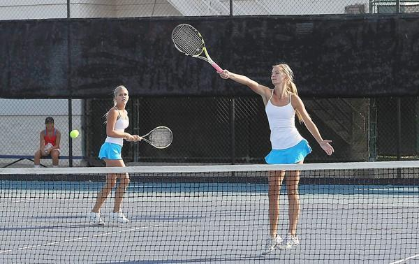 Corona del Mar's Riley Gerdau, left, and Kenzie Purcifull compete against San Marcos during a first-round match of the CIF Southern Section Division 1 playoffs.