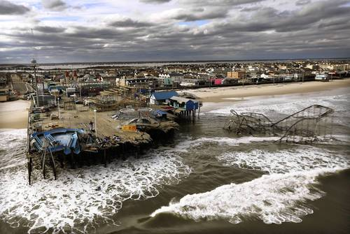 Waves break in front of an inundated Seaside Park in Seaside Heights, New Jersey, two days after being destroyed by 1,000-mile-wide superstorm Sandy.