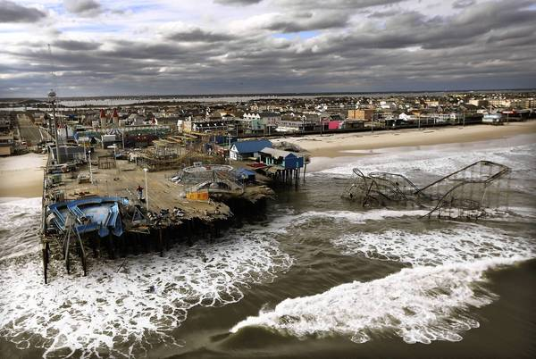 Photos: Hurricane Sandy: Waves break in front of an inundated Seaside Park in Seaside Heights, New Jersey, two days after being destroyed by 1,000-mile-wide superstorm Sandy.