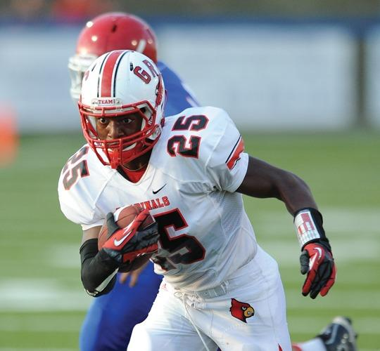 George Rogers Clark running back Darian Farris rushes for a yard against Montgomery County earlier this season in Mount Sterling. The Cardinals will take on top-ranked Louisville Trinity Friday night in Louisville.