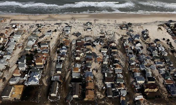 Homes sit in ruin next to the Atlantic Ocean after being destroyed by Hurricane Sandy on October 31, 2012 in Seaside Heights, New Jersey.  At least 50 people were reportedly killed in the U.S. by Sandy with New Jersey suffering massive damage and power outages.