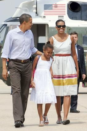 Michelle Obama and daughter Sasha work their pre-Labor Day looks as the first family heads to Martha's Vineyard toward the end of August 2009.