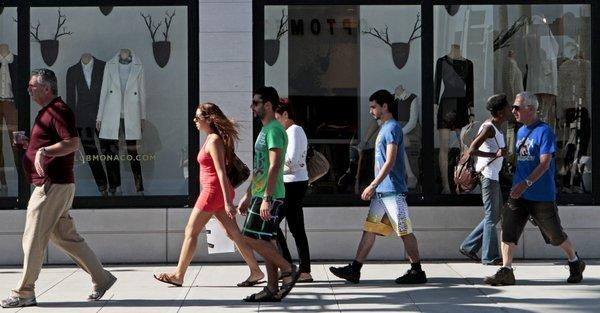 Shoppers bought more at stores in October compared to a year earlier, a report says.