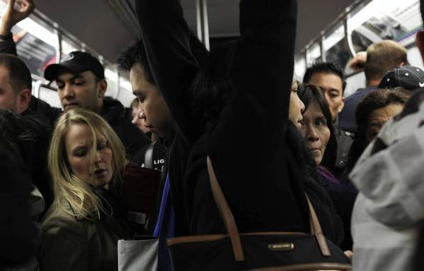 Photos: Hurricane Sandy: Commuters vie for space on the F train in New York City. Limited public transit has returned to New York. With the death toll continuing to rise and millions of homes and businesses without power, the U.S. East Coast is attempting to recover from the effects of floods, fires and power outages brought on by superstorm Sandy.